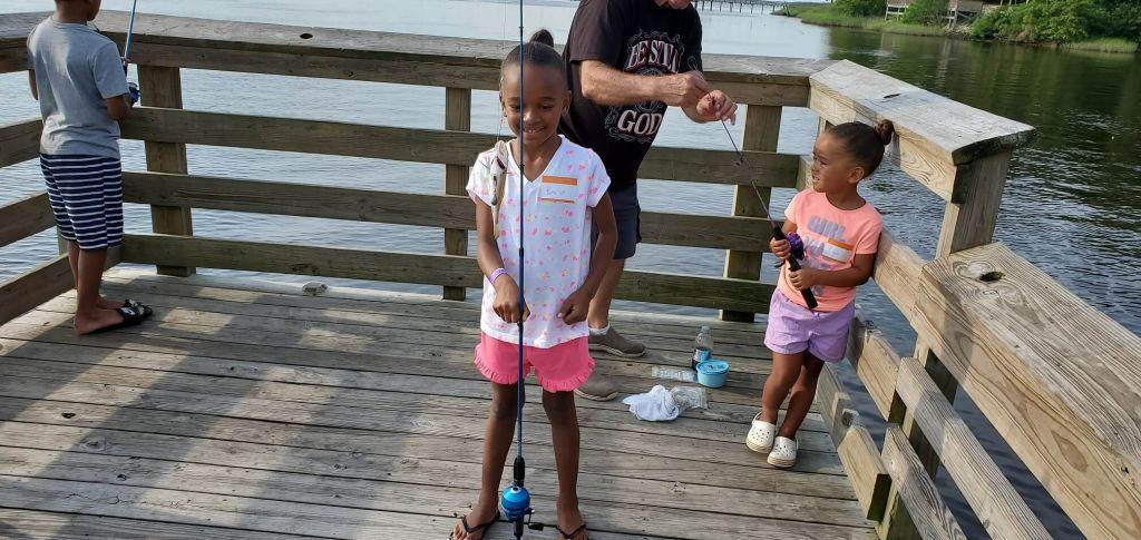 Photo of girls on fishing dock