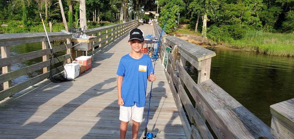 Photo of boy on fishing dock